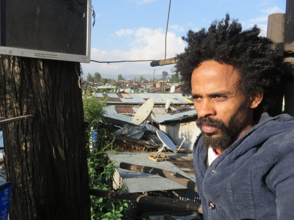 Tewodros Bekele in his tree house overlooking Mercato in Addis Ababa