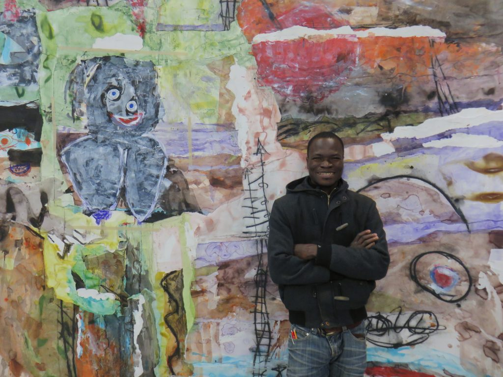 Thierry Oussou in front of his work March 2016
