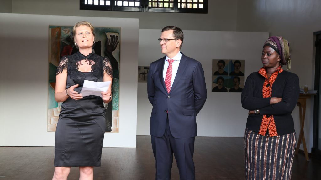 Rosalie (curator), Theo Peters (Dutch Ambassador), Kine Aw (artist) at the opening